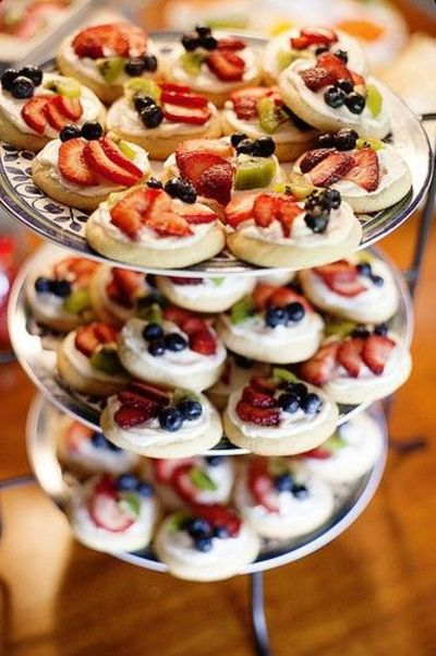 mini fruit pizza....sugar cookie, cream cheese frosting, topped with fruit. These would be great for a Baby Shower or Bridal Shower. I may even make these for Book Club.