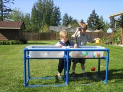 Make your own pvc piping sensory water table my next for Diy sand and water table pvc