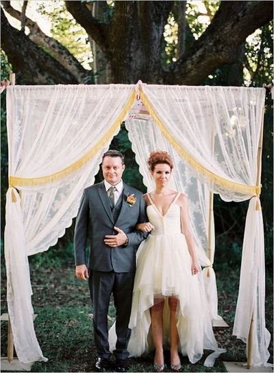 hang sheer drapes with quilt canopy from trees for wedding c