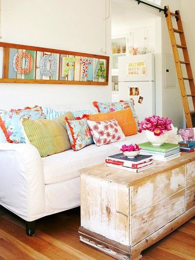 colorful accents liven this small cottage living room. see t