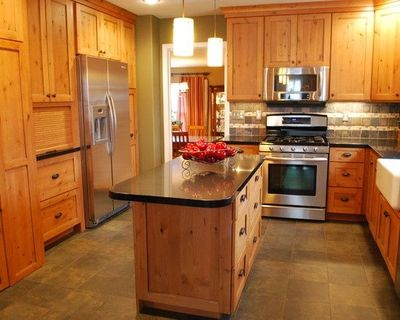 Knotty Pine Kitchen Cabinets With Black Hardware And Stone