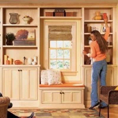 Building built in bookshelves using pre made cabinets for Pre built cupboards
