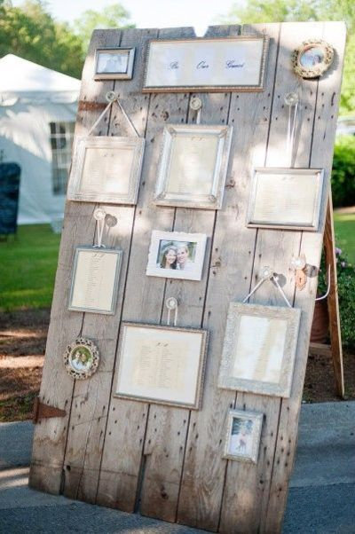 Several frames show the seating chart of a wedding for How to display picture frames on a table