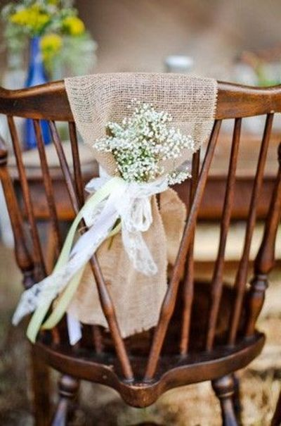 baby's breath tied with burlap and ribbon.