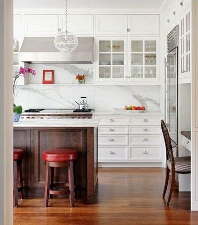white kitchen cabinets, wood island and floors, fab pendants