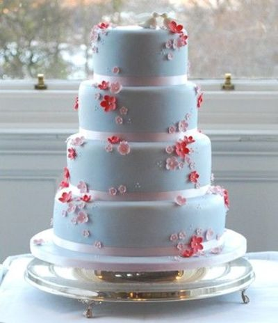 Blue Wedding Cake With Red And Pink Flowers