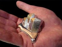 Gallium... It has a melting temperature of about 85 degrees Fahrenheit, which is basically room temperature. If you hold this metal it will begin to melt in your hand.