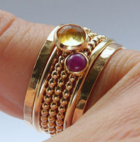 A dotted, smooth, hand hammered set of 7 x 14k GOLD FILLED stacking rings that includes bezel set, faceted Citrine & smooth Ruby stones. A lovely eye-catching Mother's Day gift!