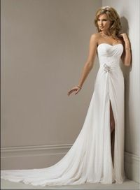 Strapless, slim line gown with sweetheart neckline and corset closure. This chiffon design features delicate detail ruching throughout the bodice met with a burst of jeweling that reveals a sexy side slit down the side skirt. This fabulous jeweling also e...