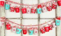 Paper Cup Advent Calendar: Wrap or buy pre-printed cups, add handles and hang with clothes pins onto a cute fabric ribbon