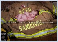 Newborn firefighter pose