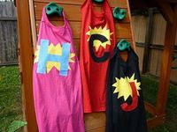 """Superhero capes - I used youth size XL tshirts instead of the suggested """"ginormous"""" tshirt. That way, the neck was not too big, so I just left it intact for pulling off and on. So easy--just cut from the back of a tshirt a cape shape, and decorate..."""