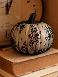 Lace pumpkin. I would use craft pumpkins for reuse year after year. I also bet you could use nylons with patterns sewn into them as well.