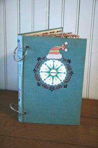 hardcover book turned into a scrapbook...would be a cute way to keep cards from each year.