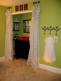 Great idea to put the changing table in the closet & use curtains to hide it!