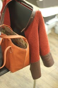 This is my friend's cadican. she knitted this and added extra piece of leather. She made the leather bag also.