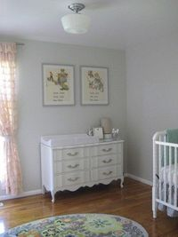 ruffle curtains, vintage prints, dresser/ changing table, spindle crib and accent rug