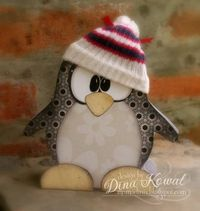 this cutie is made of paper covered wood and she's got a free download for the pattern-go get it!