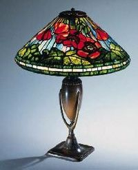 A FINE 'POPPY' LEADED GLASS AND BRONZE TABLE LAMP