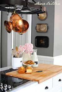 tarnished silver trays to decorate kitchen wall.