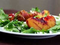 Grilled Peaches Over Arugula