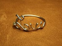 Love sterling silver wire script ring