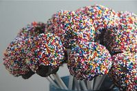 Bake a cake. Turn it into powder. Mix cake with frosting. Roll into balls. Dip. Decorate. Devour.