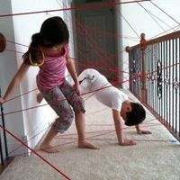 Create a hallway �€œlaser obstacle course�€ with yarn and tape to keep them busy.