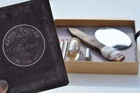 Halloween invitation: Underneath the booklet, you catch a glimpse of the survival kit contents 1. Wooden Stake for vampire slaying 2. Silver Bullet werewolf extermination 3. Holy Water exorcism rituals and warding off evil spirits 4. Mirror undead detecti...