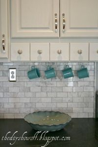 "What our backsplash will look like...except ""bone"" travertine to coordinate with our granite. Hmmm...replace the switch plates to stainless?"