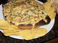 """Spicy Spinach Dip A zesty spinach dip w/ the perfect amount of melted cheese & a bit of kick from the salsa�€""""a more flavorful version of the standard spinach dip. Ingredients: 2 c. - Monterey Jack Cheese 3/4 c. (chopped) - Onion 8 ..."""