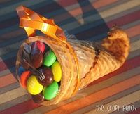 Thanksgiving,Fall cornucopia! Dip tip of waffle cone in warm water for 20 seconds next microwave for 20 seconds. Roll the softened end of the cone around a clean pencil then hold in place for 20 seconds.