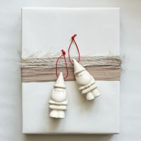 Love the white wrap with burlap and feathered cord.