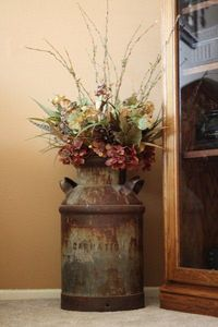 decorating with old milk cans. LOVE THIS!