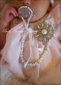 Gorgeous Baby Boutique 4-in-1 Beaded Pacifier Holder - Made with Swarovski Crystals Spacers. $27.99, via Etsy.