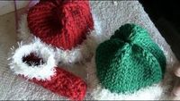 During winter, a person's body loses most of its heat through its head. Protect your baby from bitter, cold winds with a knitted santa hat or elf hat. This tutorial shows you how to use yarn for making warm hats of all varieties for your baby. You&#39...