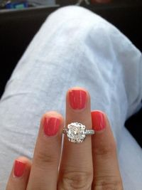 3 carat colorless, flawless, cushion cut center stone, 3 sided mico pave diamond band.