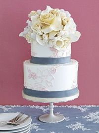 flower-topped cake with slate blue ribbon