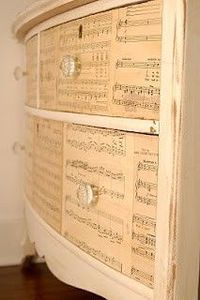 Old sheet music decoupaged onto drawers