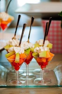 fruit with whipped cream served in martini glasses