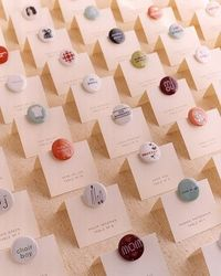 Attached to the seating cards are buttons the couple designed specially for each guest. After family and friends found their assigned tables, they could wear the buttons, which were great conversation starters.