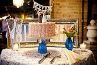 Adorable details- the topper, design on the cake and table décor!
