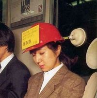 LOL, that contraption holds her upright when she nods off. Freaking Japanese inventiveness.