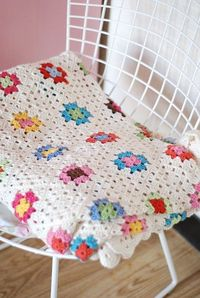 Granny Square Afghan with two rounds of white for each block.