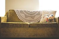 Look at the pillow. Wonderful way to use doilies.