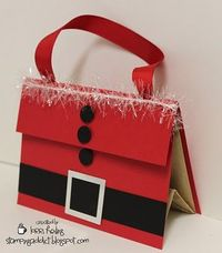 "This is a simple little gift bag decorated to look like Santa. The bag is just a basic brown paper lunch sack. Here are some dimensions for you: Back red cardstock piece is 5 1/2 x 6 1/4. The 5 1/2"" side is scored at 2"" and that will make the flap..."